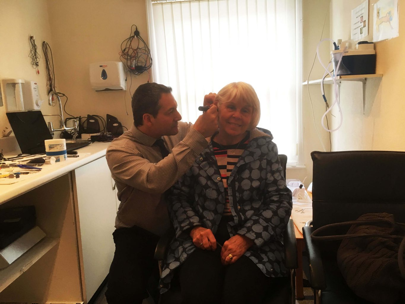anthony berg of uk hearing centres treating a patient