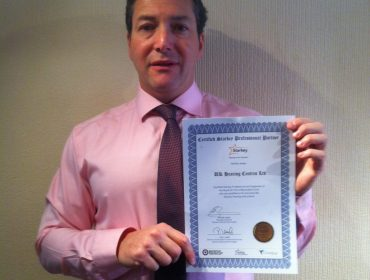 Anthony Berg with a certificate of excellence